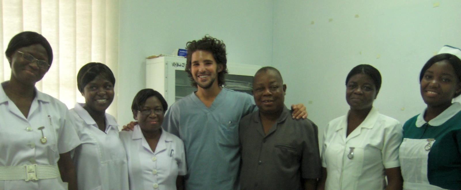 An intern on a Dentistry Project in Ghana with local medical staff at a clinic.